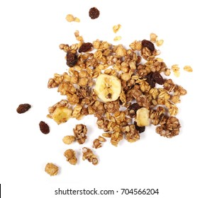 Crunchy granola, muesli pile with banana slices and chocolate isolated on white background, top view