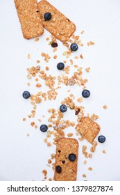 Crunchy muesli cookies and blueberries, Breakfast cereals isolated on white background, selective focus, top view.