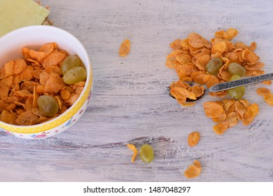 Crunchy muesli and and grape/ Breakfast cereals isolated on white background, selective focus, top view.