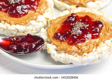 crunchy natural peanut butter strawberry jam jelly sandwich with chia seeds on rice cake bread. Proper nutrition diet vegetarian breakfast