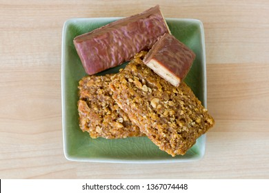 Crunchy peanut butter Energy bar with protein, coconut chocolate flavor, minerals in green plate