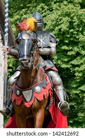 crusader with lance on warhorse going into the battle