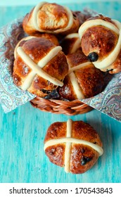 Crusades Easter buns in a wicker basket on a blue background