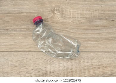 a crushed and abandoned plastic bottle