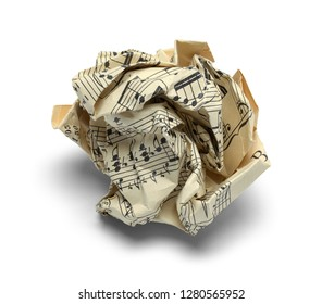 Crushed Ball Of Sheet Music Isolated on White Background.