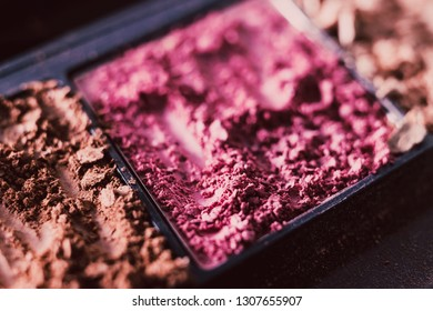 crushed blush and bronzer powders close-up shot, concept of beauty and make-up products
