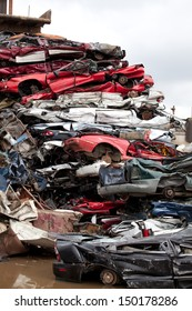 Crushed cars going to be shredded in a recycling facility