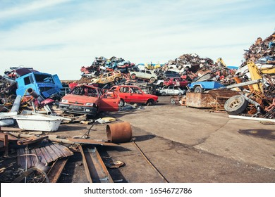 Crushed cars stacked up for recycling.