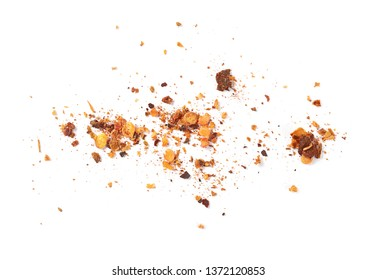 Crushed cayenne pepper and flakes pile isolated on white background