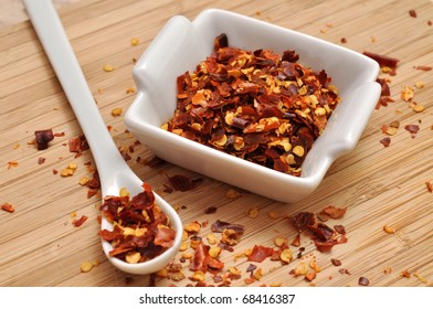 Crushed chili pepper in a white bowl