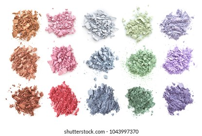 Crushed color eyeshadows isolated on white background. Top view