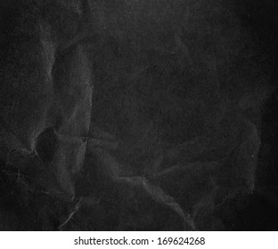 Crushed dark black paper background