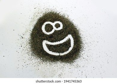 Crushed dry grass on a white background. Drawing-smiley face