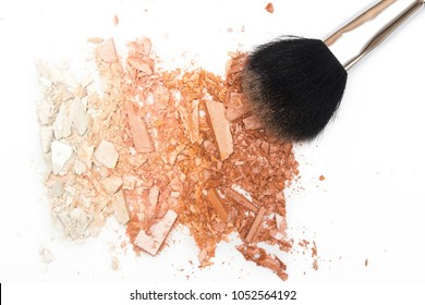Crushed face powder bronzer and cosmetic blush brush on white background