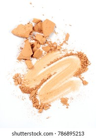 crushed face powder over white background