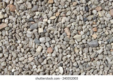 Crushed granite and pebble gravel texture, background, closeup