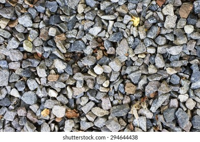 Crushed gravel texture in natural lighting