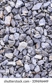 Crushed gray stone on the ground texture background