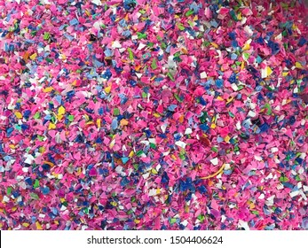 Crushed plastic granules for recycling.  Plastic crusher. Recycled plastic with mixed colors. The concept of recycled plastic used