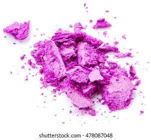 Crushed purple eye shadow isolated on white background