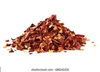Crushed red hot pepper pile / sun dried chili flakes and seeds pile isolated on white background