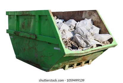 Crushed rusty green  garbage container filled with construction debris. Isolated  on white with patch sunny day shot