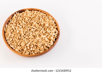 Crushed soybeans - Glycine max. Wooden bowl