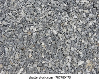 Crushed stone or angular rock is a form of construction aggregate, typically produced by mining a suitable rock deposit and breaking the removed rock down to the desired size using crushers