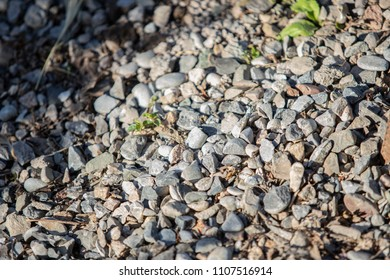 crushed stone, gravel scattered on the ground, laying gravel