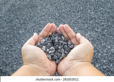crushed stone in hand