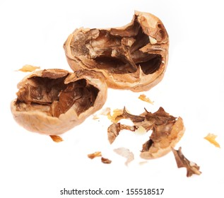 crushed walnut isolated on a white background