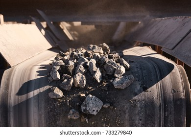 Crushing, grinding, sorting and transportation lines on slag dump. Heavy industrial metallurgical foggy landscape with construction machinery