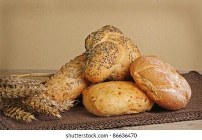 crusty bread rolls on a rustic table