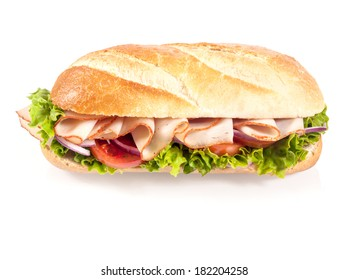Crusty Golden French Baguette With Sliced Chicken Tomato And Frilly Lettuce High Angle View