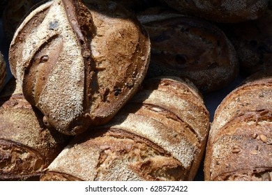 Crusty Loaves of Artisan Bread at a Farmers Market