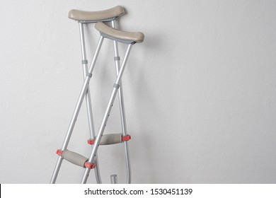 Crutches. Fractured legs. Crutches as a sign of disability. Symbol of disability. Rehabilitation in case of injury. Concept - workplace injury. Life with disabilities. Personal injury. Injuries.