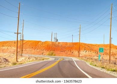 Cruve road going through dramatic minefield landscape.