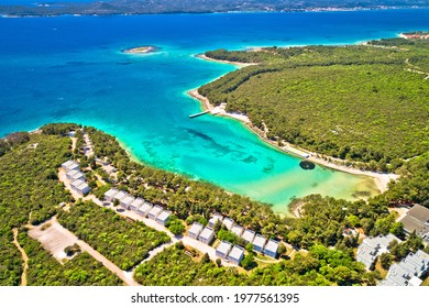 Crvena Luka turquoise beach and Vransko lake aerial view, Dalmatia region of Croatia - Shutterstock ID 1977561395