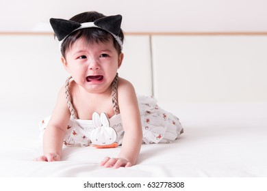 Crying Asian girl 6 months old