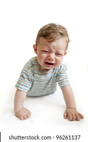 Crying baby boy on white background.