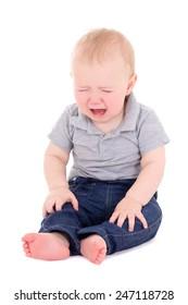 crying baby boy sitting isolated on white background