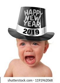 Crying baby boy wearing a Happy New Years hat, studio isolated on white. 2019