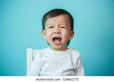 Crying baby girl, studio shot