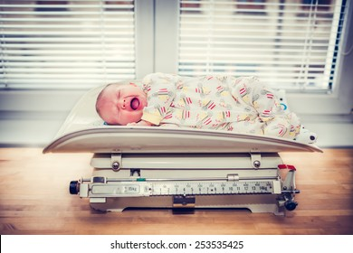 Crying Baby on a Retro Weight Scale