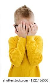 Crying boy. Isolated on white background