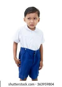 Crying boy in school uniform