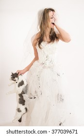 Crying bride, holding cat