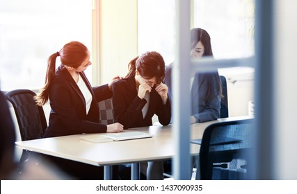 Crying businesswoman. Group of businessperson in office.