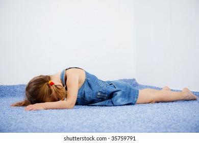 Crying child lying on the floor