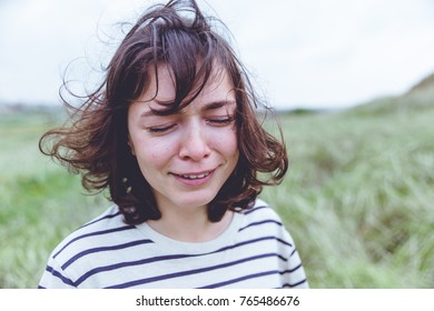 crying girl with disheveled hair outdoor